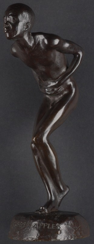 Wooden statue of a person hunched over, holding their stomach.