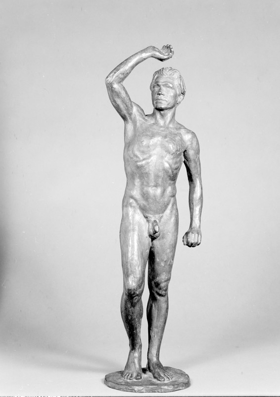 Statue of a nude man with his arm raised above his head.