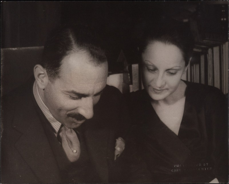 Black and white photo of Alfred A. Knopf Sr. and Blanche Knopf looking down.