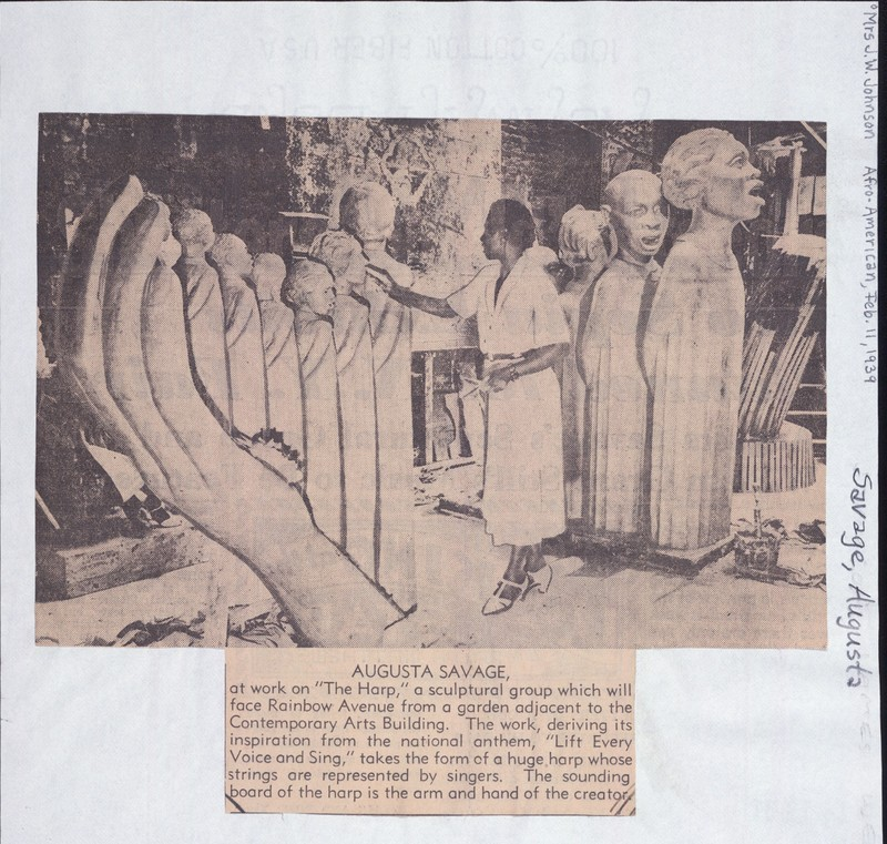 Cut out of an excerpt of a newspaper about Augusta Savage working on a new piece, beneath an image of her in the studio.
