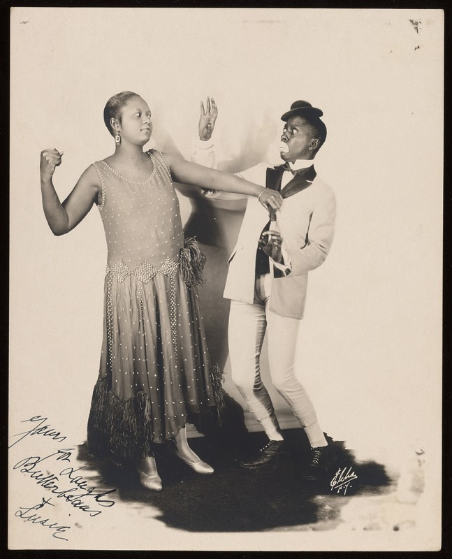"""Signed black-and-white photograph of Butterbeans and Susie, with Susie posing as if she were about to punch Butterbeans. Photo is signed,  """"Yours for Laughs  Butterbeans  +  Susie"""""""