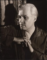 """Black and white portrait of Carl Van Vechten seated, looking to the left of the frame. Embossed: """"Photograph by Carl Van Vechten"""". Stamped verso: """"Photograph by Carl Van Vechten / Cannot be reproduced without permission""""."""