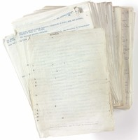Picture of a large stack of papers with faded text