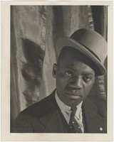 Close-up portrait of Bill Robinson in a hat